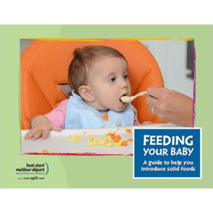 Cover of the Feeding Your Baby booklet: Baby being fed with a spoon.